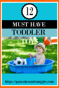 toddler boy sitting in kiddie pool with soccer ball and pail