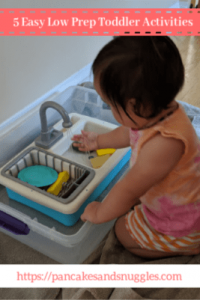 toddler playing with play sink and water