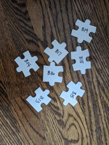 puzzle pieces labeled by number and letter